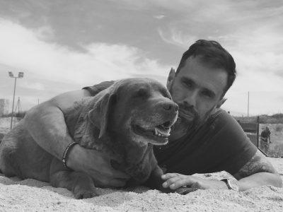 Teo Mariscal, Bocalan Foundation, cuddles with Labrador